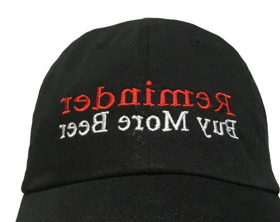 Reminder Buy More Beer (Backwards on Purpose for reading in the mirror) (Polo Style Ball Cap - Black with White Stitching