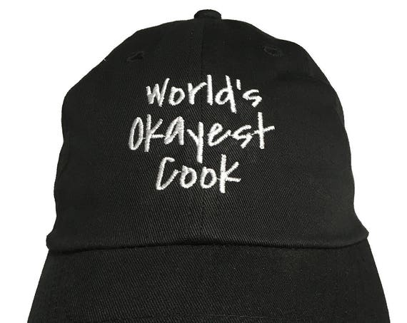 World's Okest Cook - Polo Style Ball Cap (Black with White Stitching)