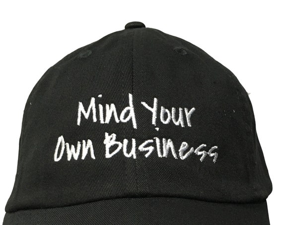 Mind Your Own Business - Polo Style Ball Cap (Black with White Stitching)