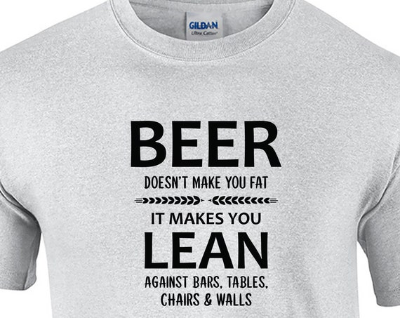 Beer Doesn't make you Fat, It makes you Lean against... (Mens T-Shirt)