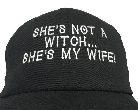 She's Not A Witch, She's My Wife!  (Embroidered Polo Style Ball Cap Available in Various Color Combos with White Stitching)