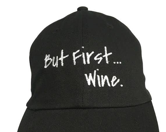 But First... Wine. - Polo Style Ball Cap (Black with White Stitching)