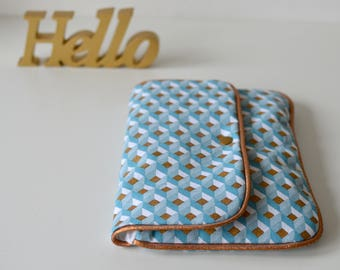 -Geometric fabric and copper piping flap pocket