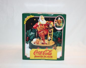 Vintage Coca Cola Mechanical Coin Bank Santa and Elf with COA in Original Packaging  2nd in series by ERTL Coca-Cola Bank Coke Memorabilia