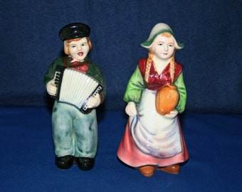 Vintage Dutch Boy playing Accordion and Girl with Jug Ceramic Pottery Figurines cold cast pair Hand Painted Figures Knick Knack Figurine