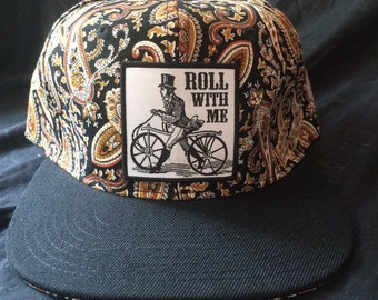 Roll With Me Cyclist Lovers Black Paisley Snapback