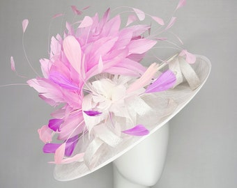 kentucky derby hat white sinamay fascinator with white feather flower and curls pink feather cascade with pink blush and purple feathers