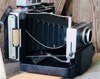 Polaroid land camera 450, with instruction manual