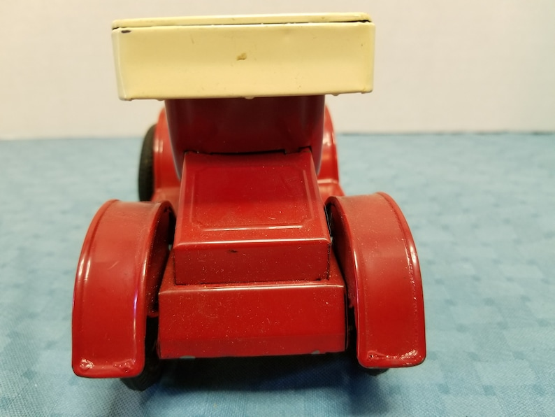Vintage old-time tin litho toy car