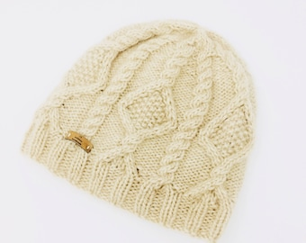 Hand knitted cashmere cap in braid pattern