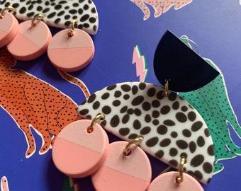 Pastel Dalmatian print drop earrings.