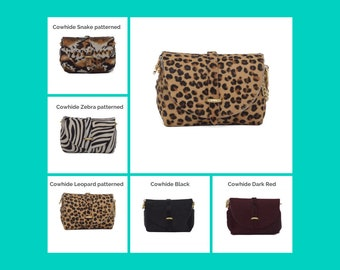 Leather and cowhide hair evening clutch bag with detachable gold chain strap