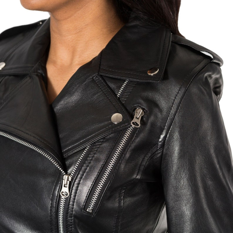 d4132f49f Womens brando style rock chick cross zip biker jacket with buckles and stud  buttons.