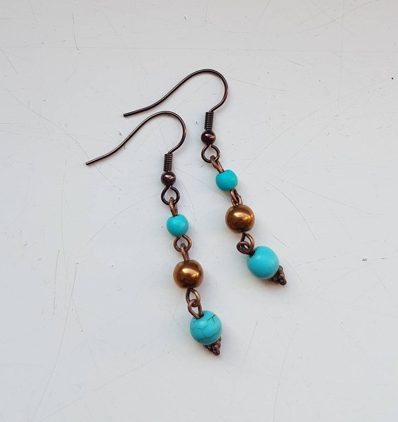JUDY  Turquoise 'n copper earrings  with howlite & image 0