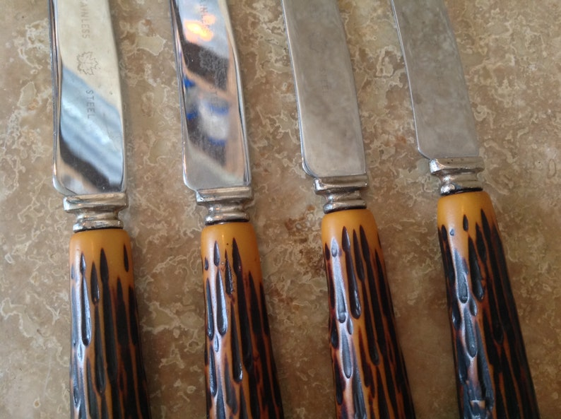 Set of 4 knives with faux antler handles
