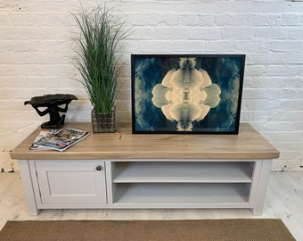 Large low and wide tv unit with shaker cupboard and open shelves. Made to order in any size with painted finish and thick rustic top