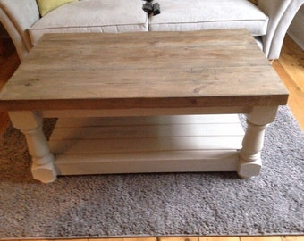 Rustic coffee table with thick reclaimed wood top and lower shelf. Made to measure in any size with chunky farmhosue carved legs
