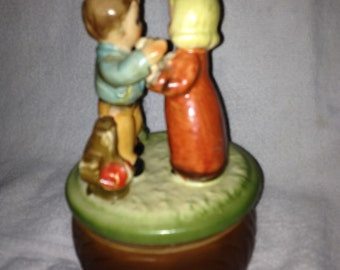 Vintage Music Box With Children Playing with chicken