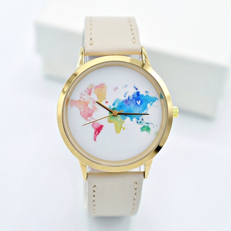 23 Best Travel Gifts for Her featured by top US travel blogger, Marcie in Mommyland: Gift for women Wanderlust jewelry World Map watch Travel watch image 0