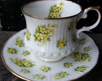 """Vintage Queen's China """"Primrose"""" part of the """"Bountyside Series"""" footed tea cup by Rosina in white with delicate yellow primrose flowers"""