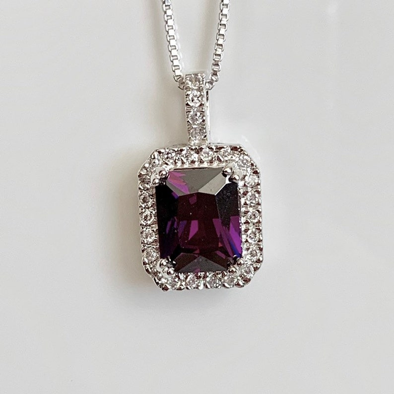 5f86d2005ff13 Sterling Silver Rhodium Plated Emerald Cut Simulated Amethyst Crystal Cz  Halo Pendant Box Chain Necklace
