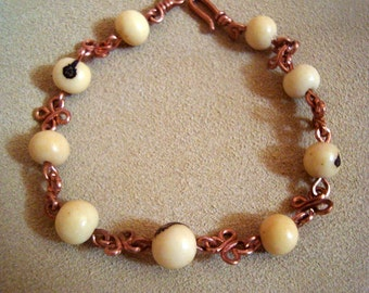 bracelet or anklet in seeds of the Brazil and copper