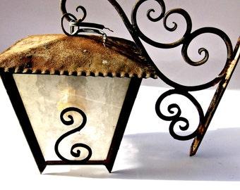 Old rusty wall lantern