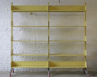 retro-yellow rolling vintage industrial cantilever massive library shelf by Estey—scalable and practical storage solution