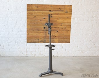 one-of-a-kind sitting or standing desk with cast iron base and custom-made upcycled top