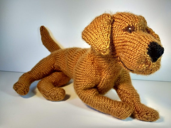Fred, a knitted puppy dog stuffed animal (Red Golden Retriever)