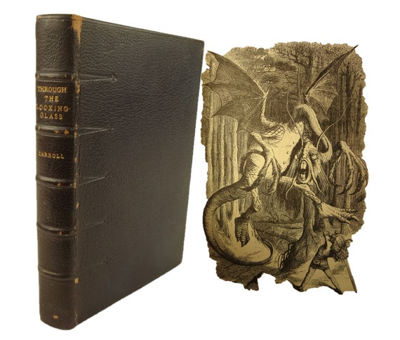 "1872 Through the Looking Glass, Lewis Carroll. 1st edition, 2nd state (""wabe""). Sequel to Alice's Adventures in Wonderland."