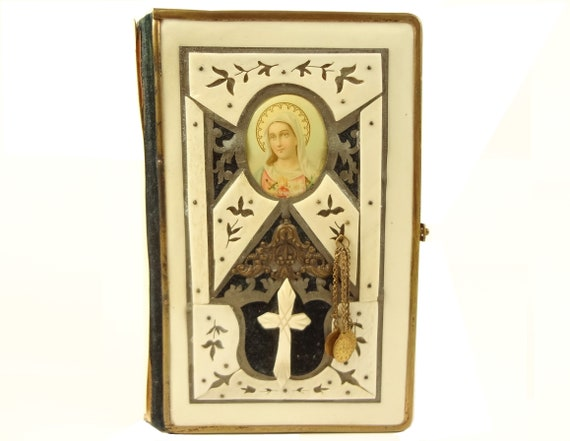 1911 Slovakian Prayer Book, Naboznych Vylevov. Binding with bone, based on purported Mary apparition in Paris, with miraculous medals.