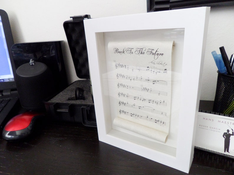 BACK To The FUTURE  scrolled sheet music framed in a white image 0