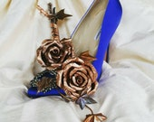 Rose and ivy flower sculp...