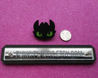 Laser cut dragon pin badge