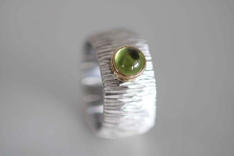 jewelry peridot unique Ring in silver with beautiful olive green peridot in gold framed by Frank Schwope silver goldsmithing gold