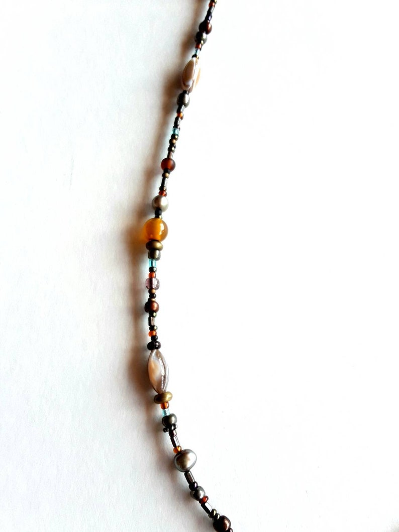 Bohemian Glass And Semiprecious Stone Beaded Necklace With Mother Pearl Cut Flaming Sun Pendant And Key Clasp Charm