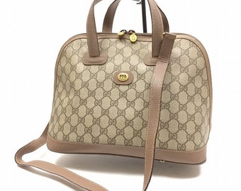 2396e7e1348 Vintage Gucci brown GG monogram Supreme bag. ALILALIA