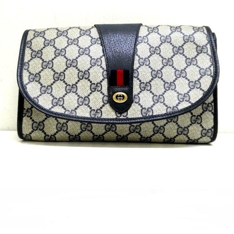 8e0e047683a Vintage Gucci navy blue GG monogram supreme clutch bag purse