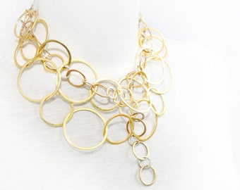 HOLES, intertwined spheres plume gold and silver