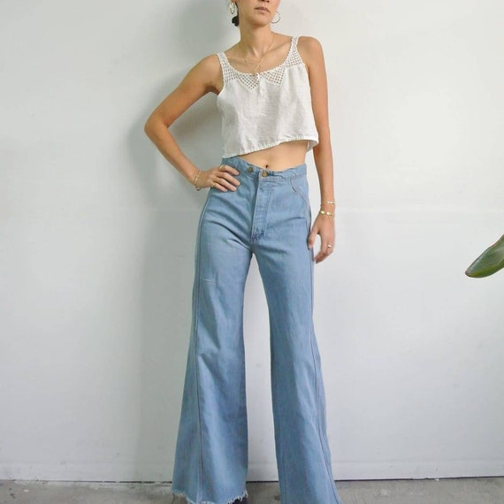 Vintage 1970s high waist light blue distressed fla