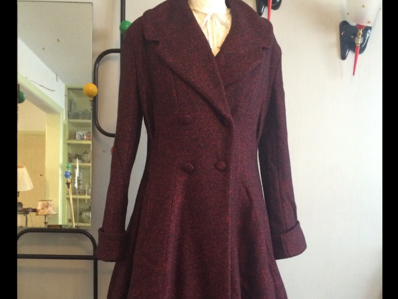 1950s Coats and Jackets History Stunning Vintage style 1950s Fit and Flare coatexclusive to Doghouse Vintage. $322.90 AT vintagedancer.com