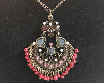 Multicolor beaded pendant on a brass colored chain