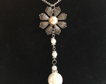 Silver pendant on chain with pearl accents
