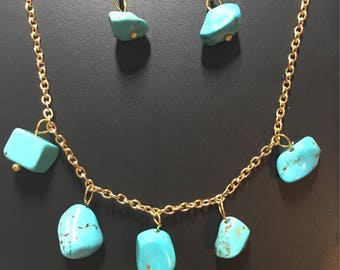 Turquoise stones on a gold necklace with matching earrings