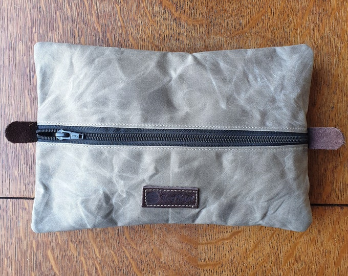 Waxed Canvas pouch to be used as dopp kit or travel gear bag and or as headphone and cables case