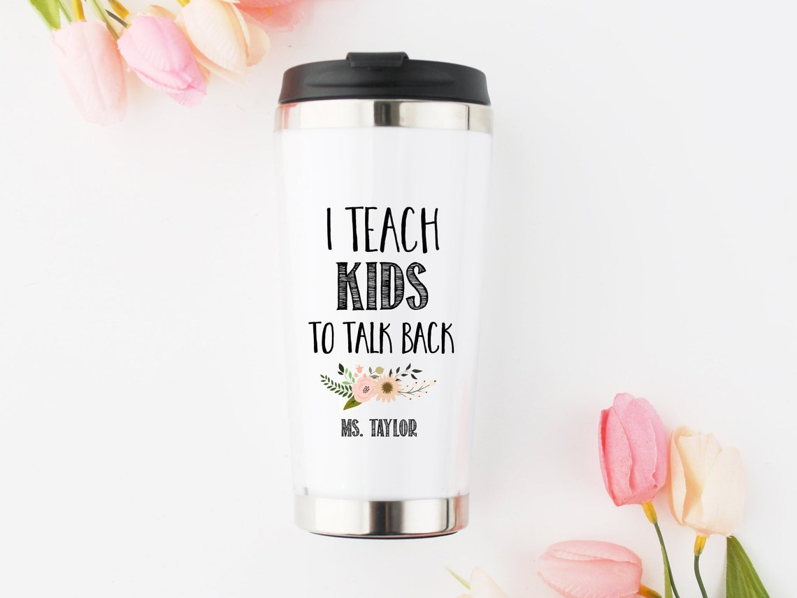 A white tumbler with words