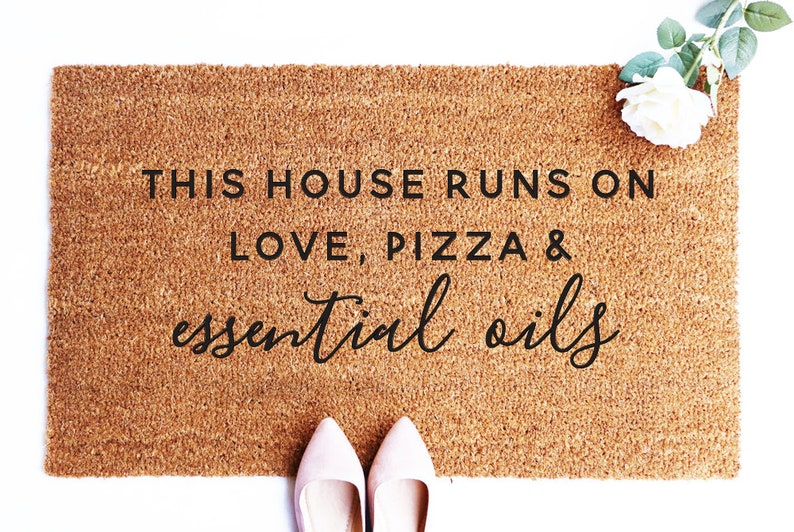Funny Essential Oils Doormat This house runs on love pizza image 0