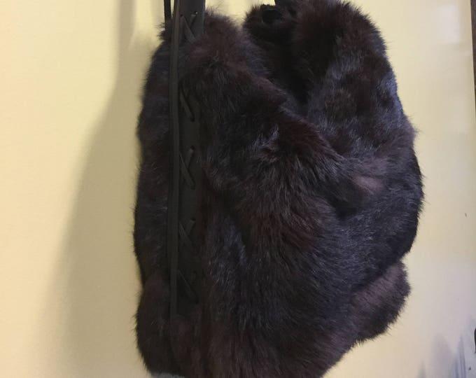 Fur Handbag with Cowhide Lacing.