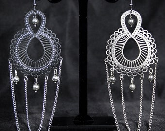 Large earring with warp and Peasley pendant